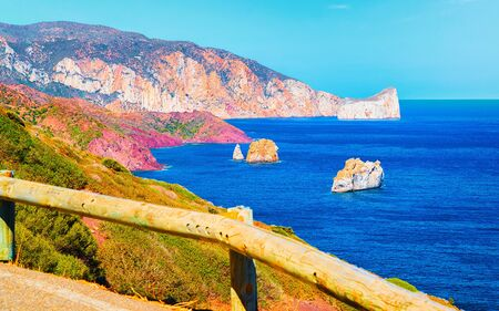 Landscape at Porto Corallo in Nebida and the coast of Mediterranean Sea at Carbonia-Iglesias, Sardinia, Italy. Scenery of Sardegna, summer. Cagliari province, Porto Cervo. Mixed media. Zdjęcie Seryjne