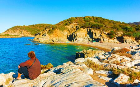 Woman and Landscape of Chia Beach and Blue Waters of the Mediterranean Sea in Province of Cagliari in South Sardinia in Italy. Scenery and nature. Mixed media.