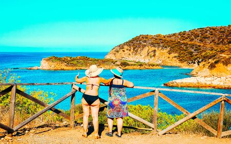 Women and Landscape of Chia Beach and Blue Waters of the Mediterranean Sea in Province of Cagliari in South Sardinia in Italy. Scenery and nature. Mixed media.