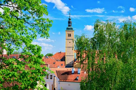 Landscape with Franciscan Church of St John the Baptist in Old city of Varazdin in Croatia. Panorama and Cityscape with Cathedral in famous Croatian town in Europe in summer. Travel and tourism
