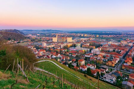 Romantic Landscape and cityscape with vineyards in Maribor in Slovenia in Lower Styria in Europe. Nature in spring in Slovenija. Sunset. Vine cesta on Piramida or Pyramid hill