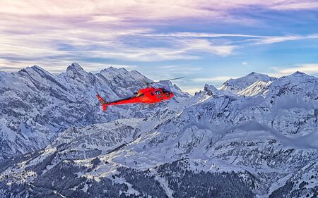 Red helicopter at swiss alps near Jungfrau mountain. Mixed media.