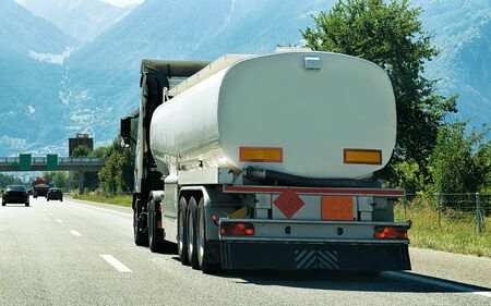 Truck cistern on the road in Valais canton, Switzerland. Mixed media.