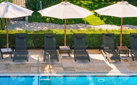 Sunbeds at swimming pool at Geneva Lake Montreux Swiss Riviera. Mixed media. Standard-Bild