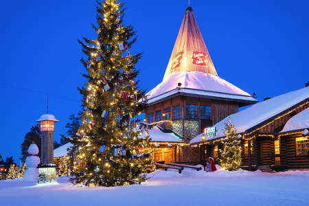 Rovaniemi, Finland - March 5, 2017: Santa Office at Santa Village with Christmas trees in Lapland, Finland, Scandinavia, on Arctic Circle in winter. At night