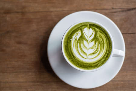 matcha: matcha green tea latte on wooden background