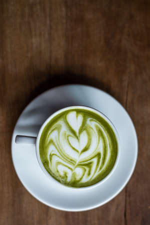 green powder: matcha green tea latte on wooden background