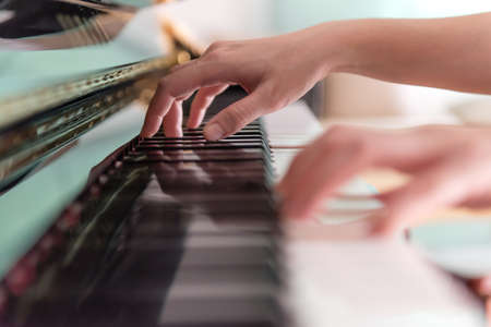 piano lesson: playing piano soft focus