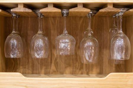three shelves: wine glasses in wine cabinet