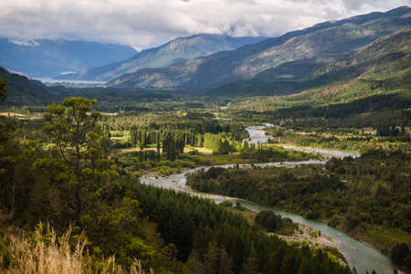 Landscape of Blue river, valley and forest in El Bolson, argentinian Patagonia