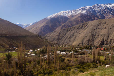 View of Pisco Elqui in the Elqui valley in Chile. Snow in the mountains at back, The Andes range tipical town