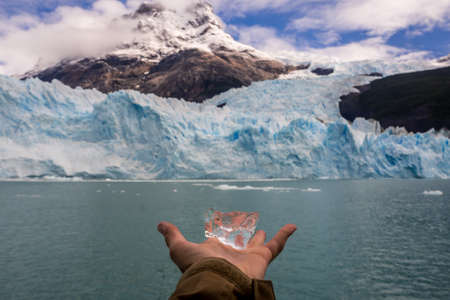 Hand showing a piece of ice from rthe spegazzini glacier in Argentina. The glaciers national Park in Patagonia