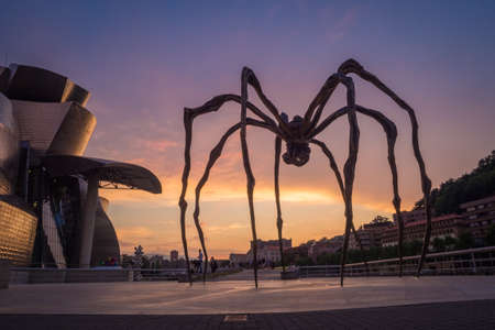 Detail of Guggenheim museum and giant spider sculpture in Bilbao during the sunset basque Country Spain