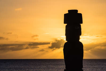Moia silhouette in Easter Island during the sunset