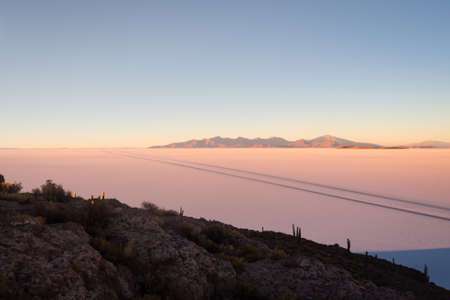 View on sunrise over island incahuasi by salt lake Uyuni in Bolivia. Panoramic