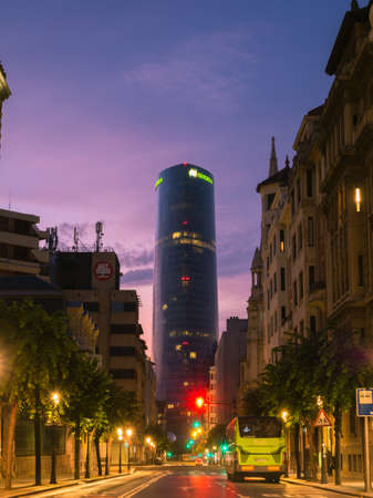 BILBAO, SPAIN - JUlY 08: Iberdrola Tower at sunset in Bilbao, Spain on July 08, 2018. The 165m tower was inaugurated in 2012 and is the highest building in Bilbao and the Basque Country. Street