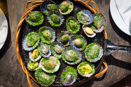 grilled limpets with green mojo, typical avocado in Lanzarote, Canary Island