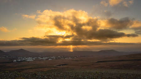 Sunbeams during sunrise from the mountain Guanapay in Teguise, Lanzarote. Canary Island