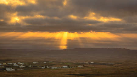 Sunbeams during sunrise from the mountain Guanapay in Teguise, Lanzarote. Canary Island Stock Photo