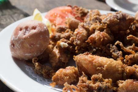 Fried chopitos, typical dish of Spanish food. Chopitos de lanzarote with crumpled potatoes. Canary Island Фото со стока