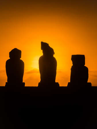Backlighting sunset in Ahu Tahai, Easter Island. Moais in Rapa Nui
