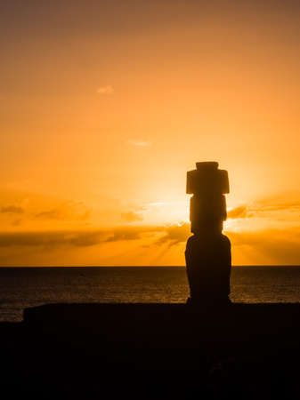 Moai shilouette in the Ahu Tahai during the sunset, Easter Island, Chile, South America