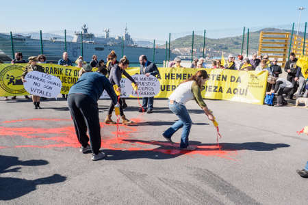 BILBAO, SPAIN - MARCH  232019. People protesting the arrival of the aircraft carrier of the Spanish Navy Juan Carlos I in the port of Bilbao during open day to visit the ship. Editorial