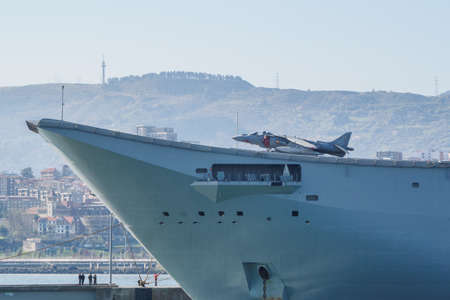 BILBAO, SPAIN - MARCH  232019. The aircraft carrier of the Spanish Navy Juan Carlos I in the port of Bilbao, open day to visit the ship. Sunny day Editorial