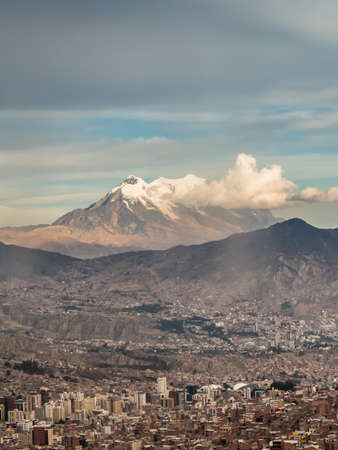 Panoramic cityscape in La Paz in Bolivia. High snow mountain in the back