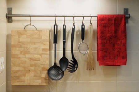 kitchen utensils hanging on the wall Imagens