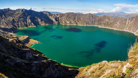 Panoramic of the volcano lake of Quilotoa, Ecuador. With a little kayak inside