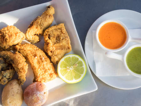 Fried moray eel with salt potato, accompanied by mojo picon and green mojo. Typical dish of the cuisine of the Canary Islands