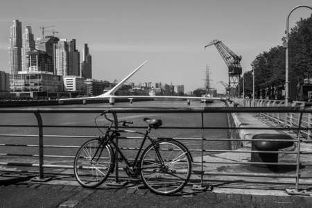 Bicycle in Puerto Madero in Buenos Aires and the Puente de la Mujer in the background, Argentina