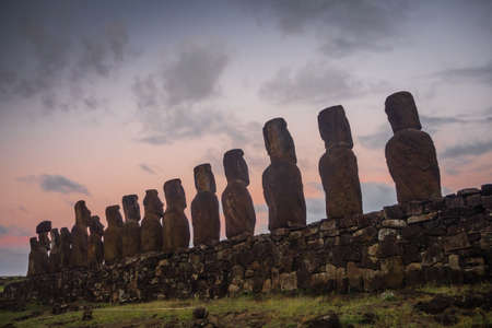 Silhouettes of Ahu Tongariki moai, Easter Island in Chile during the sunrise