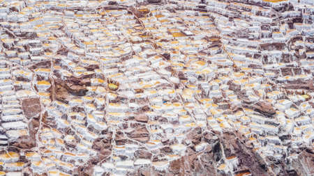 Detail of the salt terraces in the salt pans of Maras, salineras de Maras near Cusco in Peru, salt mines made by man Фото со стока - 131992181