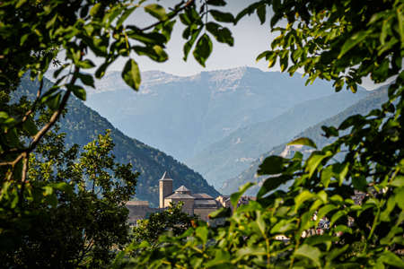 View of the church of Torla de Ordesa in the National Park of Ordesa and Monte Perdido in the Pyrenees of Huesca Фото со стока - 131992333