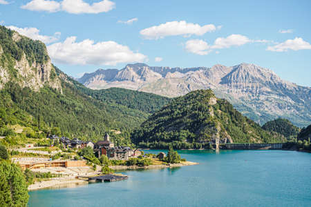 View of the town of Lanuza and the reservoir of the river Gallego in the Pyrenees of Aragon in Spain