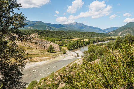 View of the abandoned village of Janovas and the Ara river in the Pyrenees of Huesca in Spain Archivio Fotografico
