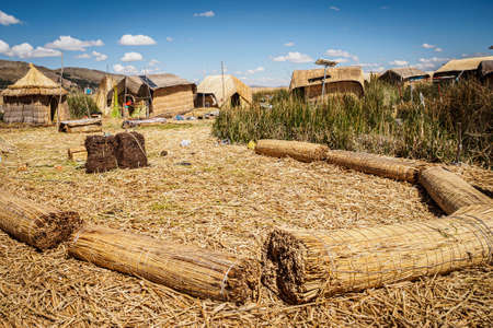 Island made of totora by the Uros on Lake Titicaca in Peru. Hand made contruction Фото со стока - 131750483