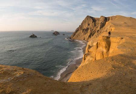 Coast of Paracas in Peru during the sunset. Desert coast in Peru