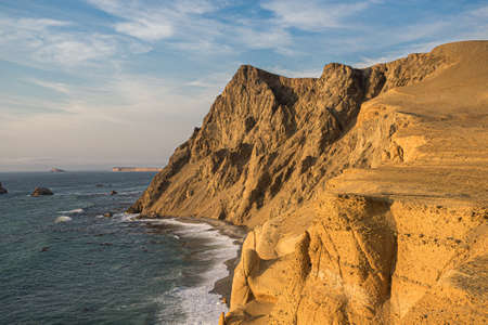 Coast of Paracas in Peru during the sunset. Desert coast in Peru Фото со стока - 131750228