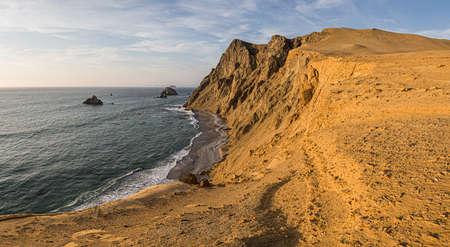 Coast of Paracas in Peru during the sunset. Desert coast in Peru Фото со стока - 131750162