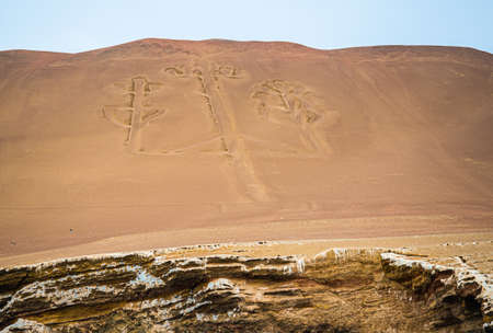 The candelabro, pre-Inca ruins on the coast of Paracas in Peru. Detail photo