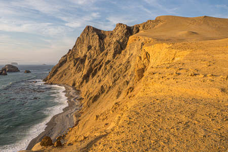 Coast of Paracas in Peru during the sunset. Desert coast in Peru Фото со стока - 131750533