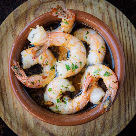 Garlic prawns, traditional Spanish tapas on and ceramic bowl.