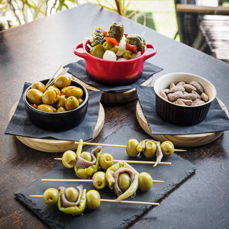 different types of spanish tapas, banderillas, gildas, olives and almonds