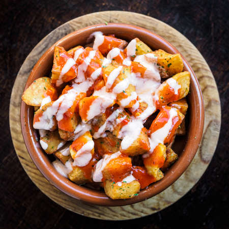 Spanish potatoes patatas bravas for tapas with tomato and spicy sauce on a bowl Фото со стока - 131750150