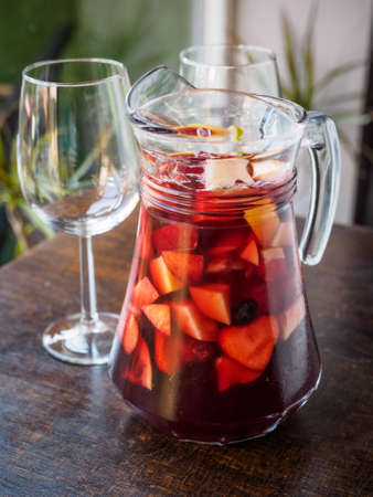 typical spanish sangria drink on a pitcher with glasses