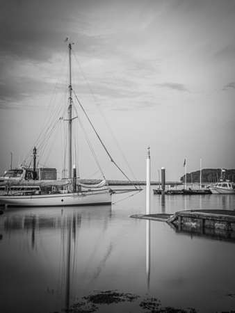 Long exposure photography from the West Cowes docks, in front of the Royal Yacht Squadron on the Isle of Wight
