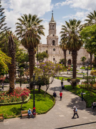 Plaza de armas of the city of Arequipa in southern Peru. The cathedral and palm trees